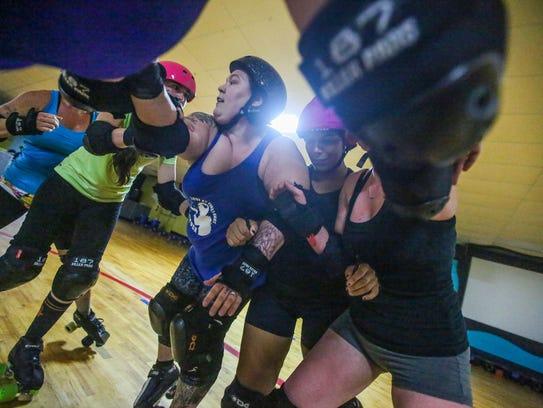 Fort Myers Derby Girls Alisha Morgan, Gretchen Frey