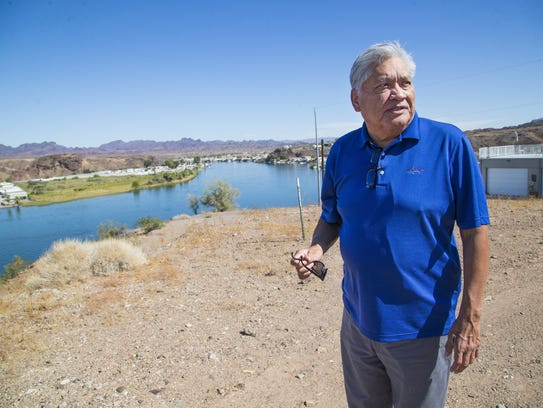 Colorado River Indian Tribes Chairman Dennis Patch stands near the Colorado River in Parker. The tribes are looking for ways to lease some of their river-water allotment to thirsty parts of Arizona.