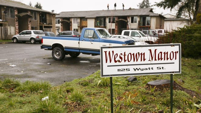 Contractors work on one of the buildings at Westown Manor apartment complex in Stayton on Wednesday, March 8, 2017. The previous owner of the complex was based out of California, but the apartments were recently sold to Tom Youmans, owner of Aumsville-based TRY Investments.