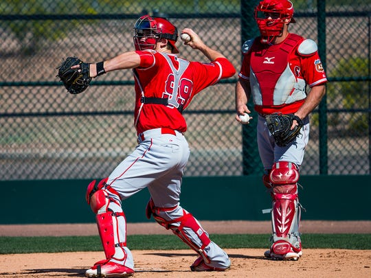 Los Angeles Angels of Anaheim catcher Taylor Ward, left,  works out with the team at the Tempe Diablo Stadium Complex in Tempe, Arizona, Tuesday, March 1, 2016.