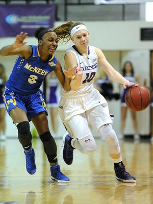 ​Abilene Christian's Breanna Wright (10) brings the ball up court while being guarded by McNeese State's Caitlin Davis (3) during the fourth quarter of the Wildcats' 77-65 win on Saturday, Jan. 28, 2017, at ACU's Moody Coliseum.   ​