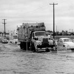 THEN: Looking west on the south side of McDowell Road at the Indian Bend Wash in 1967 before the the water control projects were built in Scottsdale. The wash is located 1/4 mile west of Hayden Rd.