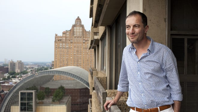 Rossen Milanov has served as music director of  Symphony in C since 2000. He's shown here in his Center City apartment in 2010.