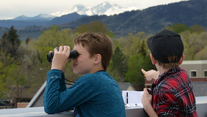 Payton Harrison, left, and Joshuah Gilstrap look out over Fort Collins during the Fourth Grade Rendezvous at the Fort Collins Museum of Discovery on Monday, April 24, 2017.