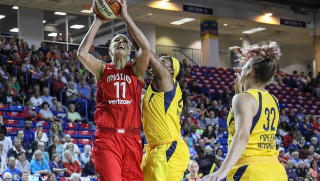 Washington Mystics forward Elena Delle Donne (11) drives past Indiana Fever forward Stephanie Mavunga (23) on the way to the basket in the second period of a WNBA preseason basketball game between the Indiana Fever and the Washington Mystics at the Bob Carpenter Sports Convocation Center in Newark on Saturday, May 12, 2018.