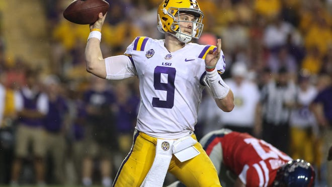 Sep 29, 2018; Baton Rouge, LA, USA; LSU Tigers quarterback Joe Burrow (9) passes against the Mississippi Rebels during the second quarter of a game at Tiger Stadium. Mandatory Credit: Derick E. Hingle-USA TODAY Sports