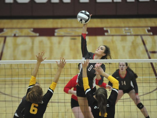 Lexi Evak smashes one at the net in the fourth game
