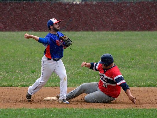 Hallam second baseman Zach Zambito makes the throw