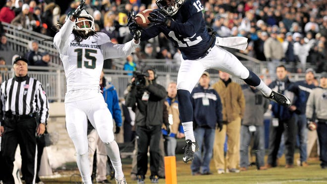 Nov 29, 2014; University Park, PA, USA; Michigan State Spartans cornerback Trae Waynes (15) defends on a pass intended for Penn State Nittany Lions wide receiver Chris Godwin (12) in the second quarter at Beaver Stadium. Mandatory Credit: Evan Habeeb-USA TODAY Sports