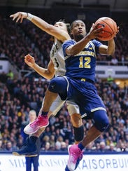 Michigan's Muhammad-Ali Abdur-Rahkman shoots past Purdue's