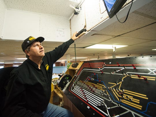 "Bill Hudson of the Delmarva Model Railroad Club watches over a set of tracks. ""One wrong flip, there could be a crash,"" he says."