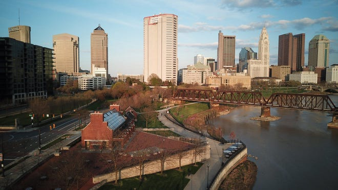 The sun illuminates the downtown Columbus skyline from the North Bank Park area along the Scioto River on Thursday, April 16, 2020.