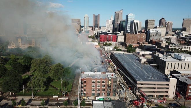 Columbus firefighters battle a blaze at the construction site of The Residences at Topiary Park apartment building on South Washington Avenue Downtown on Sunday morning.