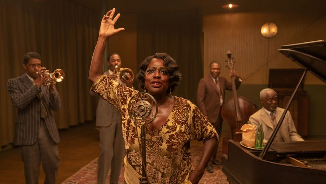 Ma Rainey (Viola Davis) belts out the blues at a recording session.