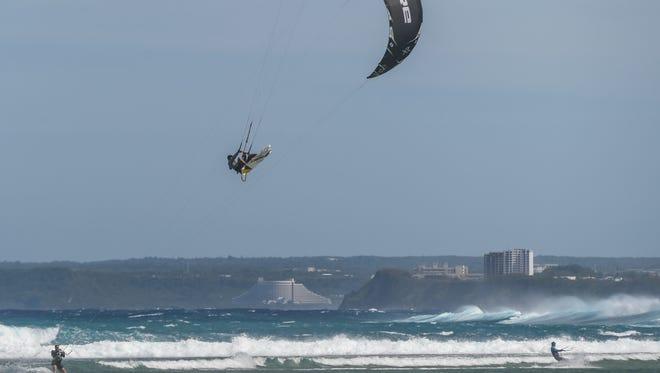 Kite surfers take advantage of a breezy day and rough seas near Asan Beach Park on Jan. 27.