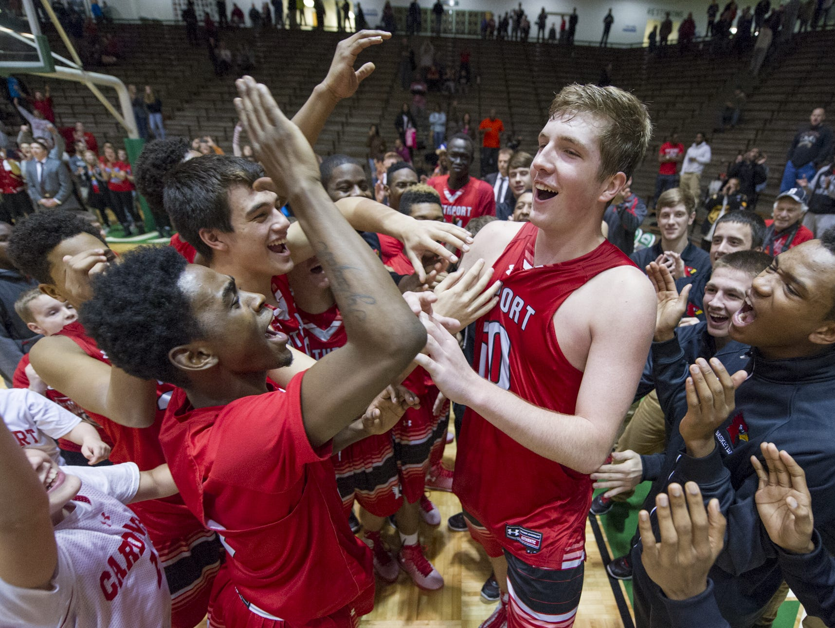 Southport players celebrate after winning the 2014 City Securities Hall of Fame Classic at New Castle Fieldhouse.