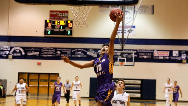Kirtland Central's Jariah Setzer drives to the basket for a layup during the first quarter of Thursday's game at Piedra Vista. It was KC's fourth game against a 6A opponent this season.