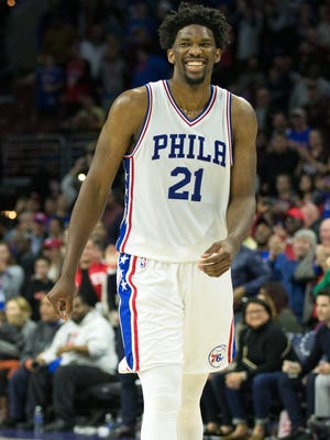 Philadelphia 76ers center Joel Embiid reacts as time winds down on a victory against the Charlotte Hornets at Wells Fargo Center.
