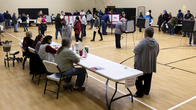 An early morning rush for voting was on a few minutes after the polls officially opened on Election Day at Sacred Heart-Griffin's West Campus, Tuesday, November 3, 2020, in Springfield, Ill.