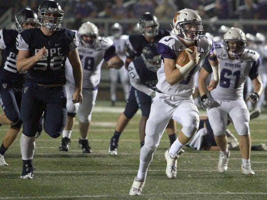 Father Ryan QB Seamus O'Connell rushes to the endzone
