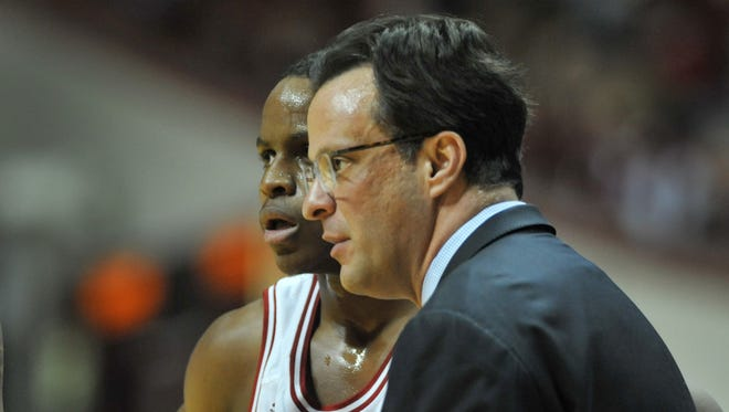 Can Tom Crean (right) and Yogi Ferrell (left) turn Indiana's fortunes around next season, with a new cast of characters in Bloomington?