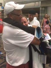 Spring Grove's Hali Flickinger hugs her father, Doug