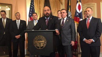 Ohio Speaker Cliff Rosenberger, center, announces a compromise on unemployment compensation reform. Lawmakers agreed to stall a massive overhaul until at least April.
