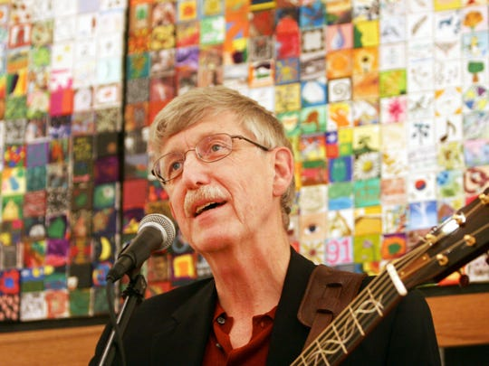 Francis Collins sings a song at the Collins Cooperative Mosaic Opening Exhibition at the R.R. Smith Center in this file photo.