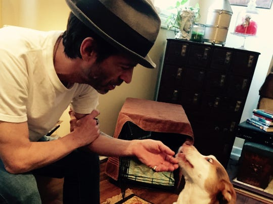 Songwriter Travis Meadows and his new dog, Larry.