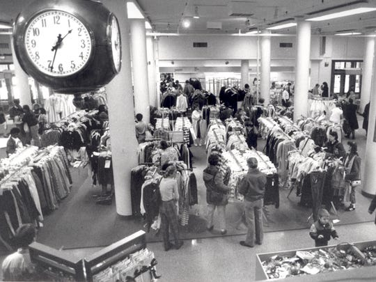 Shoppers flock to Sibley's to take advantage of 50 percent markdowns during the downtown store's going out of business sale in 1990.