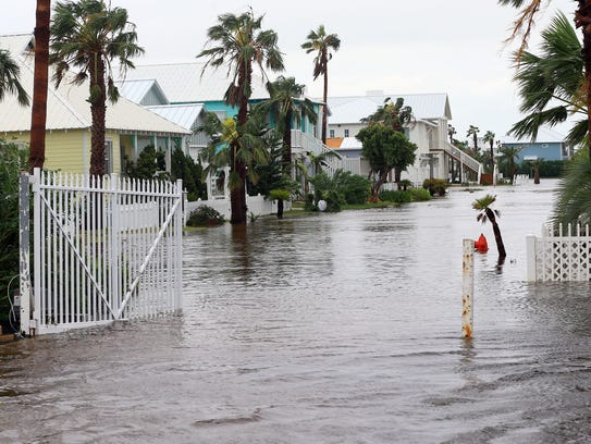 Homes in Port Aransas are flooded on Saturday, Aug. 26, 2017 after Hurricane Harvey made landfall in the Coastal Bend.
