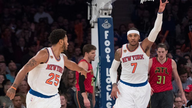 Atlanta Hawks forward Mike Muscala (31) and guard Kyle Korver, center, react as New York Knicks forward Carmelo Anthony (7) and guard Derrick Rose (25) celebrate after Anthony scored a goal during the second half of an NBA basketball game, Sunday, Nov. 20, 2016, at Madison Square Garden in New York.
