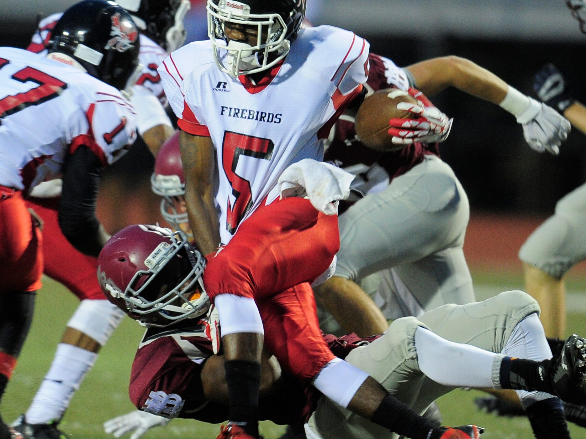 Pearl-Cohn running back Rontavius Groves (5) is pulled down by a MBA defender during their game this season. The Firebirds have just one loss.