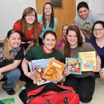 WCU students pack books, clothing, toys and other items to distribute during a service trip to Jamaica.