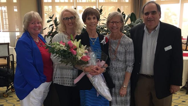 Junior League of Indian River 2018 Woman of Year Anne Lanier, center, with Mental Health Association Fund Development Manager Mary Silva, left, Marketing Manager Amy Wagner, association board Chair Dr. Karen Mersky, and Executive Director Dr. Robert Brugnoli.