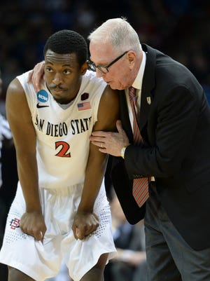 San Diego State Aztecs head coach Steve Fisher (right) talks to guard Xavier Thames (2) against the North Dakota State Bison in the second half of a men's college basketball game during the third round of the 2014 NCAA Tournament at Veterans Memorial Arena.