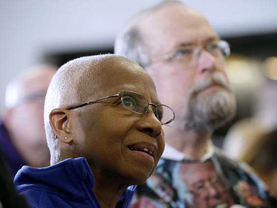 Kittie Weston-Knauer and her husband Max Knauer, of Des Moines, Iowa, listen as Democratic presidential candidate, Sen. Bernie Sanders, I-Vt., speaks during a stop at the United Steelworkers Local 310L union hall, Tuesday, Jan. 26, 2016, in Des Moines, Iowa.