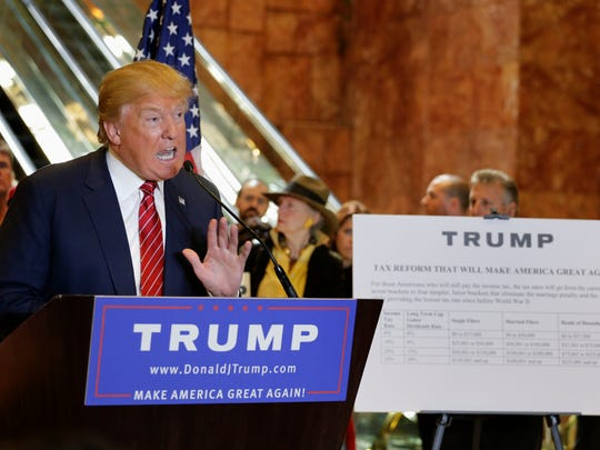 Donald Trump talks about his tax plan during a news