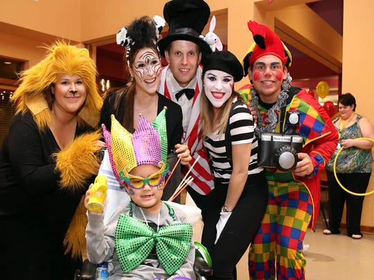 "From left, Sophia Gross, Brittany Hebert,  Eric Trump, Jennifer Palladina, Jerry Kaufman and, in front, a St. Jude Children's Hospital patient from Covington, Louisiana, were at the Sky High for St. Jude ""Circus Carnival."" Feb. 20, 2015."
