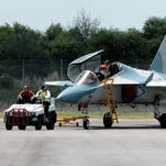 An Aermacchi M-346 fighter jet is towed to a display area at the Singapore Airshow in 2010.