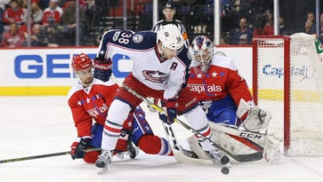 Blue Jackets center Boone Jenner (38) shoots the puck on Capitals goalie Braden Holtby (70) in the first period.