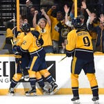 Predators left wing James Neal (18) is congratulated by center Ryan Johansen (92) after his second-period goal against the Ducks at Bridgestone Arena.