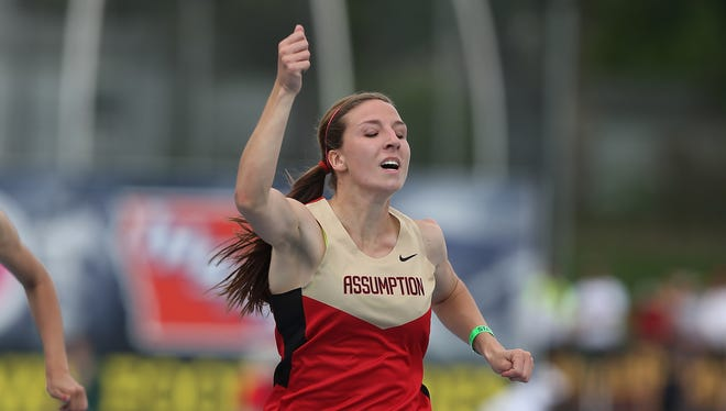 Davenport Assumption senior Rose Ripslinger celebrates after winning the 200-meter dash in Iowa Class 3A on Saturday, May 24, 2014, during the Iowa state high school track and field meet at Drake Stadium in Des Moines.