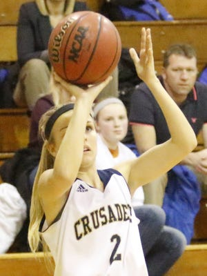 Maura Glovins of Elmira Notre Dame takes a shot earlier this season against Tioga. The Crusaders can clinch the IAC South Large School title at home Friday against Watkins Glen.