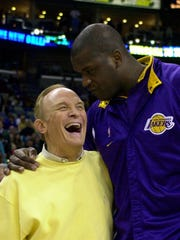 Former LSU and NBA great Shaquille O'Neal (right) shares a laugh with his former coach in Baton Rouge, Dale Brown, prior to a game in 2003. O'Neal and Brown were inducted into the College Basketball Hall of Fame on Sunday.