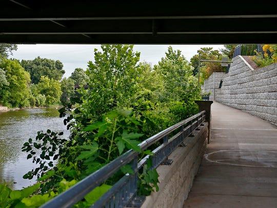 A riverwalk runs along the White River at Logan in