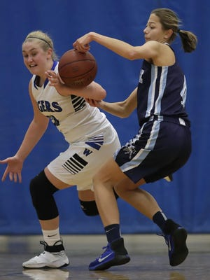 Wrightstown's Alexis Wolske (33) battles for a loose ball against Little Chute's Hannah Vandenberg (4) during a girls basketball game Tuesday.