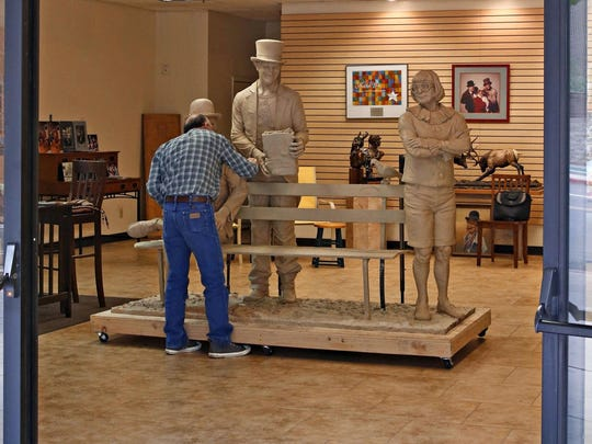 Sculptor Neil Logan works on his sculpture of Wallace and Ladmo in a downtown studio space provided by the city of Phoenix on November, 25, 2015. After casting, the life sized bronze will be places in front of the Herberger Theater.
