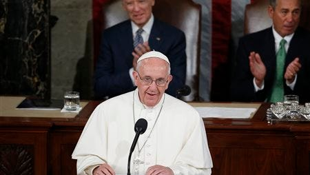Pope Francis addresses a joint meeting of Congress on Capitol Hill in Washington, Thursday, Sept. 24, 2015, making history as the first pontiff to do so. Listening behind the pope are Vice President Joe Biden and House Speaker John Boehner of Ohio. (AP Photo/Carolyn Kaster)