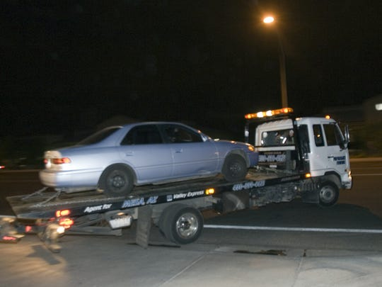 A car is brought away by a tow truck at the Windscape